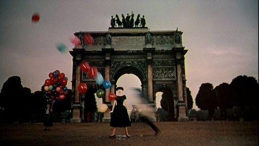funny-face-audrey-hepburn-black-dress-balloons-arc-de-triomphe-1-50s-vintage-clothing